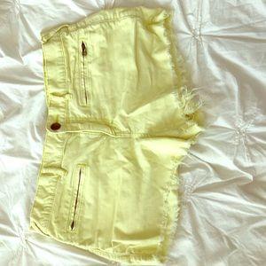 Women's sz. 31 Free People yellow cut off shorts